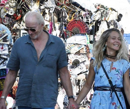 Charles Dance, 73, and his new Italian film maker sweetheart, 53, appreciate a sentimental walk around Venice after THAT hot kiss